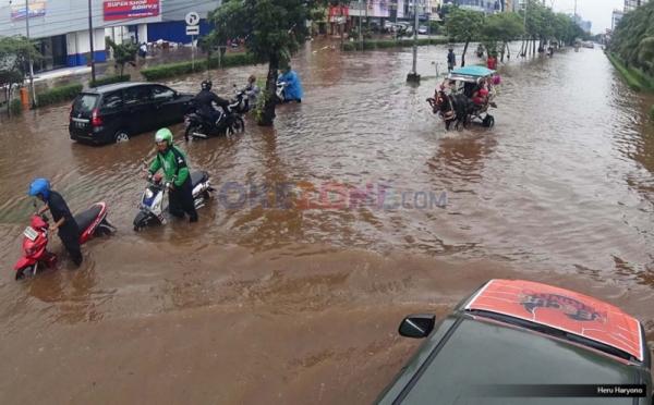 https: img-o.okeinfo.net content 2017 03 23 338 1649748 waduh-rawa-buaya-dan-duru-kosambi-terendam-banjir-IvUEF5RGTO.jpg
