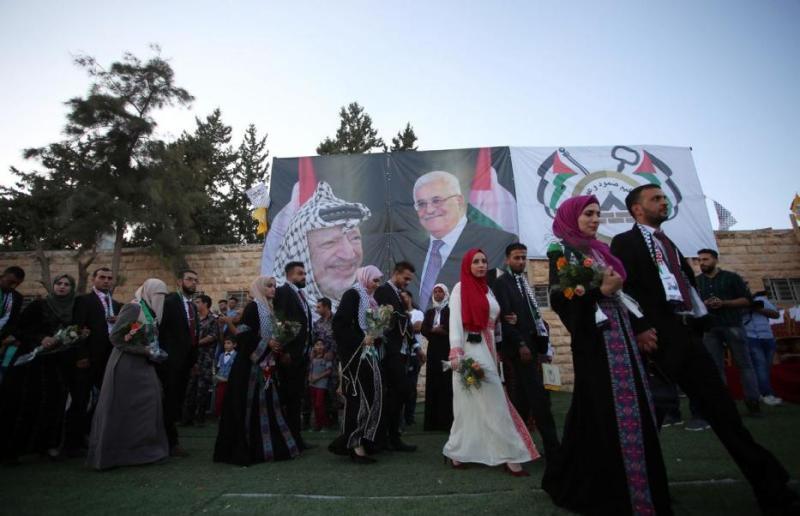 https: img-o.okeinfo.net content 2017 08 12 18 1754716 mantap-presiden-palestina-sponsori-pernikahan-massal-warga-kamp-pengungsi-yVwpC9hskW.jpg