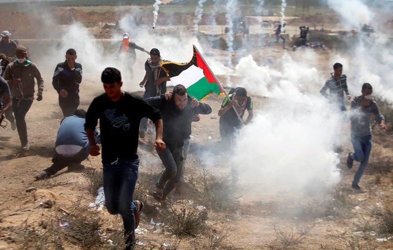 https: img-o.okeinfo.net content 2018 05 15 18 1898372 47-warga-palestina-tewas-ditembak-pasukan-israel-saat-demo-di-gaza-900-orang-luka-luka-dHu4OaADQF.jpg