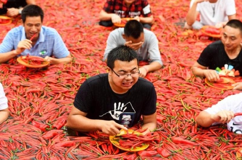 https: img-o.okeinfo.net content 2018 07 09 298 1919957 serunya-festival-makan-cabai-di-china-hadiahnya-koin-emas-24-karat-seberat-3-gram-Ja7mj6NDSo.jpeg
