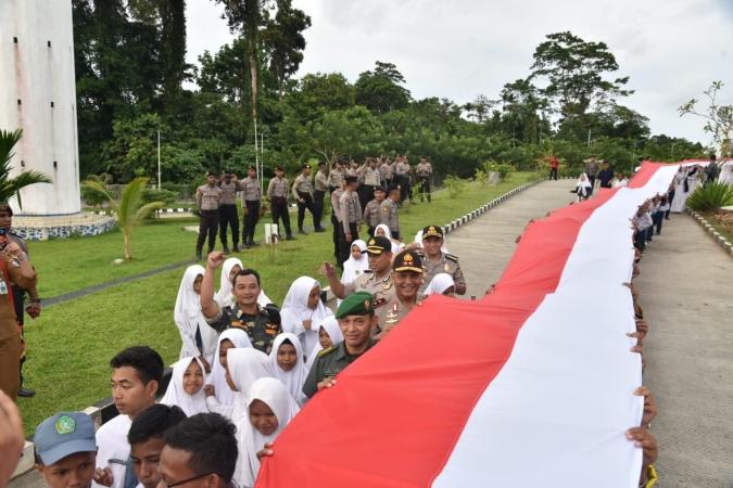 https: img-o.okeinfo.net content 2018 09 17 340 1951841 di-batas-papua-nugini-ansor-bentangkan-bendera-merah-putih-1-500-meter-gerVY3bBpg.jpg