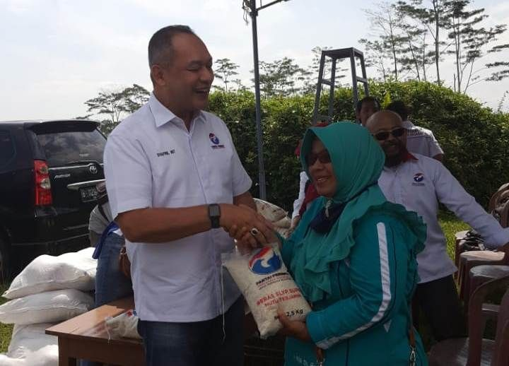 https: img-o.okeinfo.net content 2019 03 15 606 2030614 syafril-nasution-layani-warga-kendal-dapatkan-beras-murah-SZHQ3Wb3gk.jpg