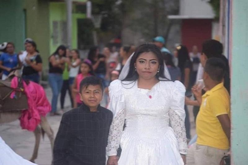 https: img-o.okeinfo.net content 2019 05 13 196 2054861 viral-foto-bocah-menikah-dengan-perempuan-dewasa-ternyata-ini-faktanya-DqRaqslS47.jpg