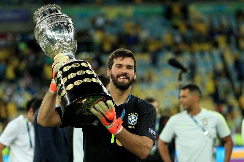 https: img-o.okeinfo.net content 2019 07 09 51 2076692 klopp-langsung-kirim-pesan-ke-firmino-dan-alisson-usai-bantu-brasil-juarai-copa-america-PJ3VIrccwf.jpg