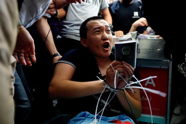 https: img-o.okeinfo.net content 2019 08 14 18 2091684 global-times-sebut-wartawannya-ditahan-pedemo-dibebaskan-polisi-hong-kong-8mggsRkuXz.jpg