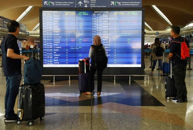 https: img-o.okeinfo.net content 2019 08 23 18 2095664 sistem-bandara-kuala-lumpur-bermasalah-penumpang-diminta-tiba-lebih-awal-g9g09Hl4be.jpg
