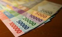 IHSG Cetak Rekor, Rupiah Malah Melemah ke Rp13.350 USD