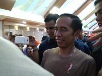 Jokowi Hadiri Deklarasi <i>Millenial Road Safety Festival</i> di Jembatan Ampera Palembang