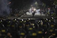 Polisi Pukul Mundur Massa Aksi 22 Mei di Gereja Theresia