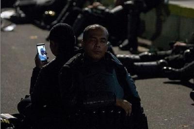 Fotografer di Balik Viralnya Foto Polisi Video Call Anak saat Amankan Aksi 22 Mei