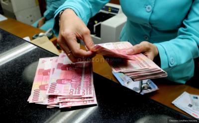 Rupiah Menguat di Rp14.066 USD, Investor Pantau Pertemuan The Fed