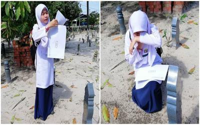 Bikin Haru, Siswi Berhijab Bacakan Hasil Ujian di Makam Ibunya